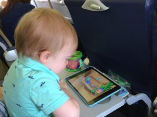 Toddler on Airplane with iPad