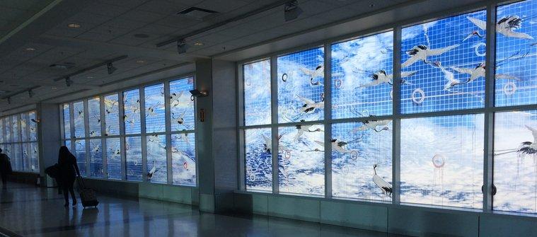Navigating Oakland Airport with Kids: Mural in Terminal 2 walkway