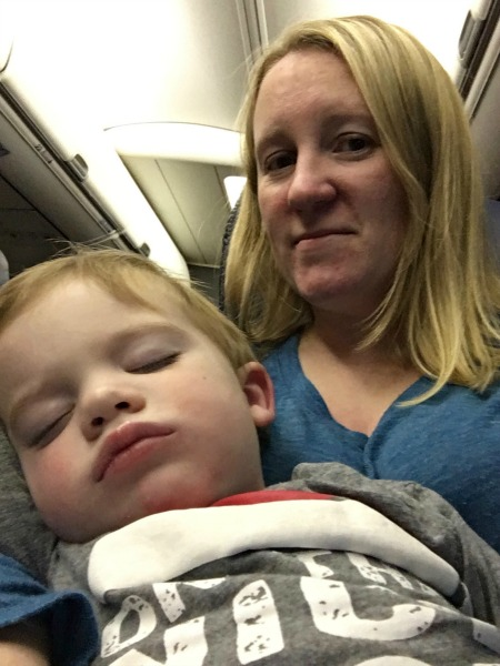 Track Your Tykes Travels - Baby Asleep on Plane