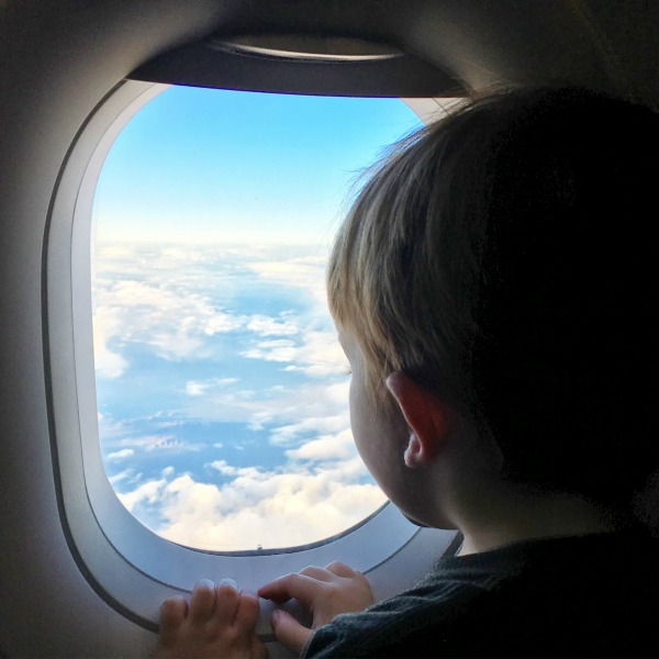 Trip with Toddler - Looking out airplane window in flight