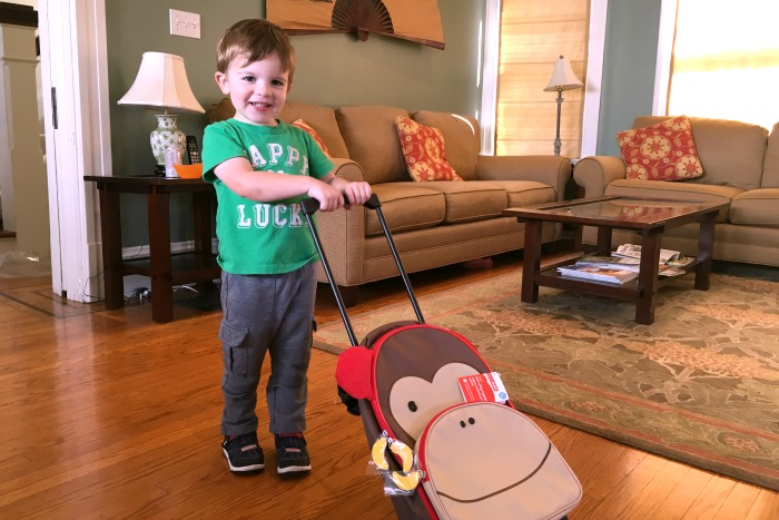 7 Ways to Avoid Airline Fees - Toddler with Carryon bag