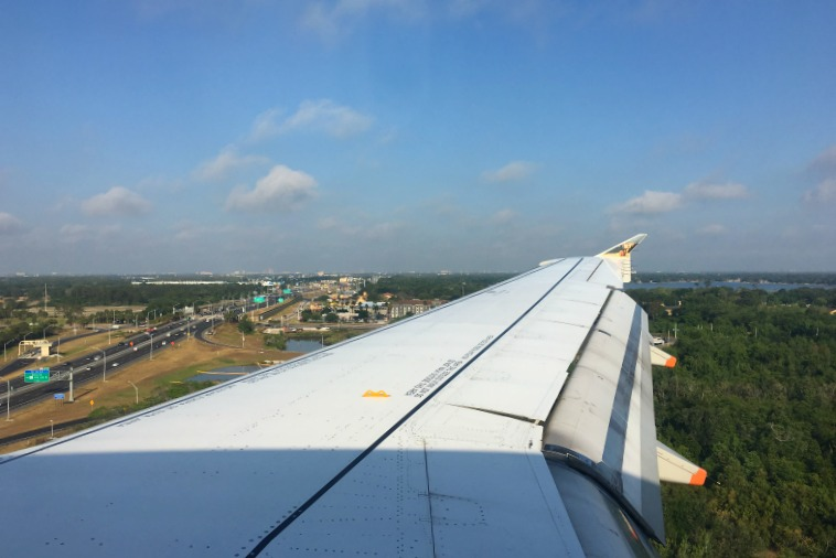 View from the wing on takeoff flying Frontier Airlines