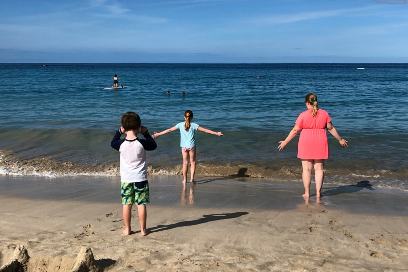 Taking Kids Out of School for Travel - Family on Beach in Hawaii