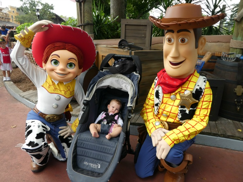 Baby in Disneyland with Toy Story Characters in City Mini Stroller