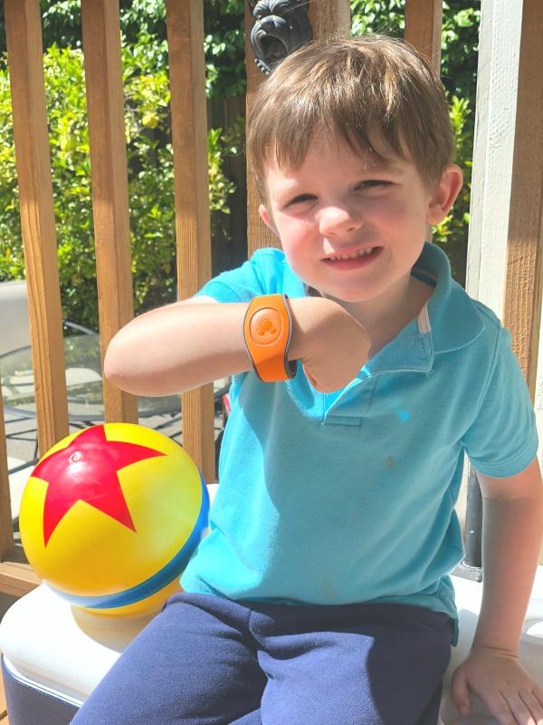 Disney World MagicBands - Child Wearing Orange MagicBand