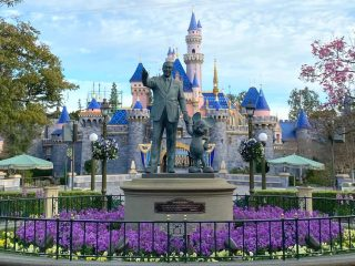 New Disneyland castle and partners statue