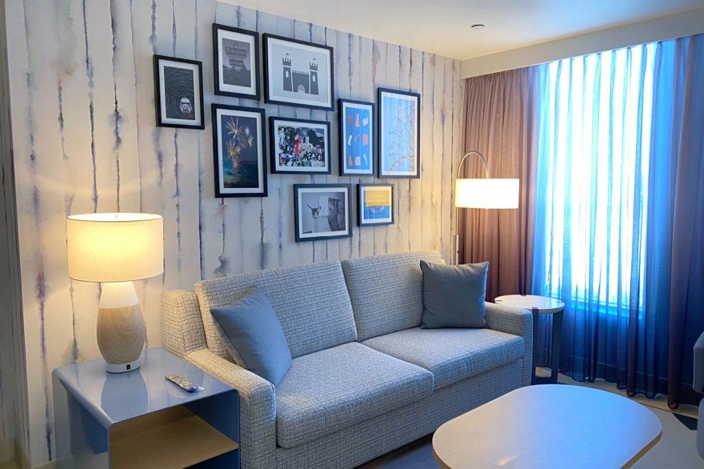 Radisson Blu Anaheim - Living Area with Disney decor in Suite Room