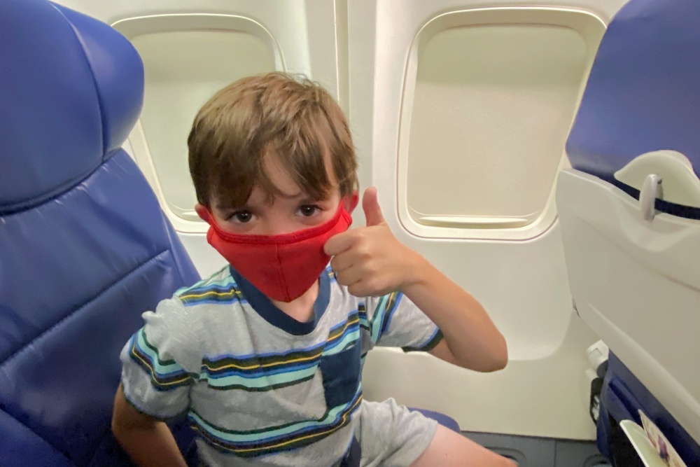 Child on Airplane with Mask in Summer 2021