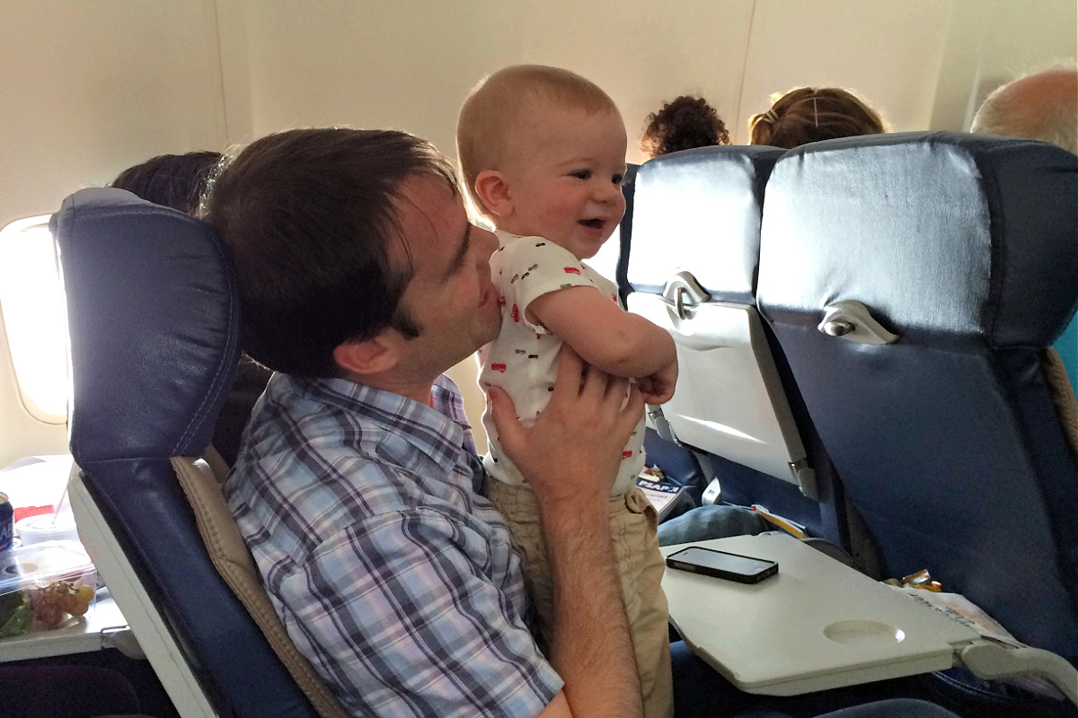 Flying with a toddler in dad's lap