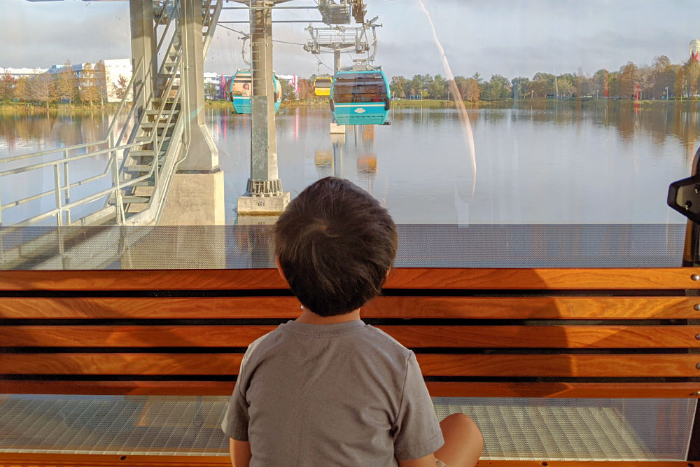 Child riding Disney Skyliner